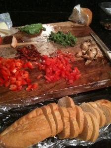 Chop all ingredients for bruschetta